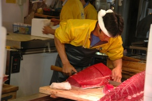 NRT Tokyo - Tsukiji Fish Market cutting fresh tuna for sushi and sashimi  production 02 3008x2000